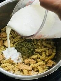 making creamy pesto sauce