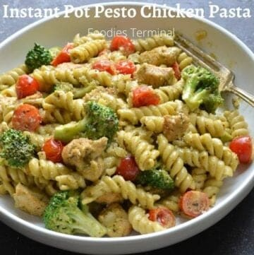 Instant pot pesto chicken pasta in a white bowl with a silver fork