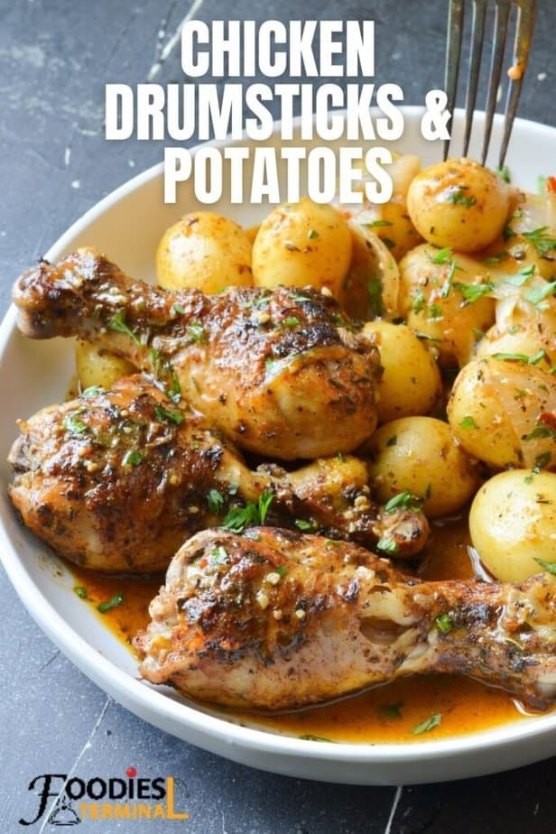 pressure cooker chicken drumsticks and potatoes in a white plate and a fork being inserted in a baby potato